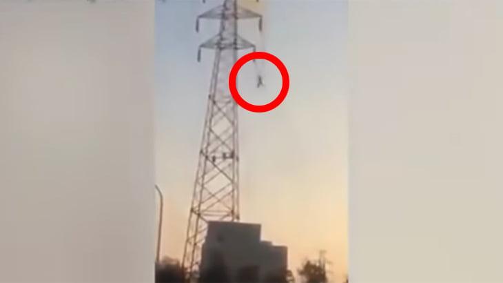 3万ボルトで感電し、30メートルの高さから落ちる男性の動画。