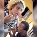 女性からビンタされながらオッパイにしゃぶりつく男。