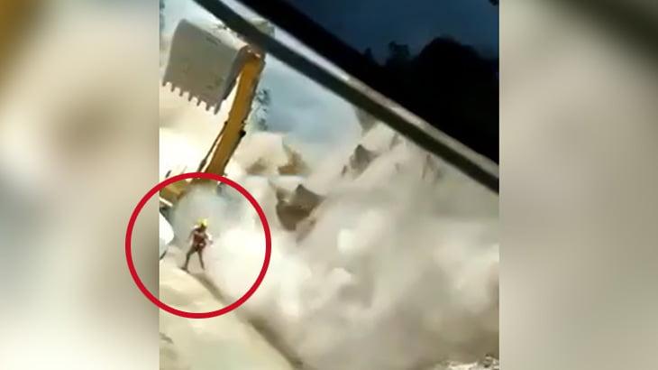 【衝撃映像】突然の地すべりに飲み込まれてしまう作業員の男性。