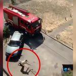 火事現場に駆けつけた消防車の目の前で火事とは関係ない建物から飛び降り自殺する男の映像。