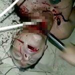 【閲覧注意】殺害した男性の首をナイフで切り、さらにスコップで叩き切ろうとするグロ動画。