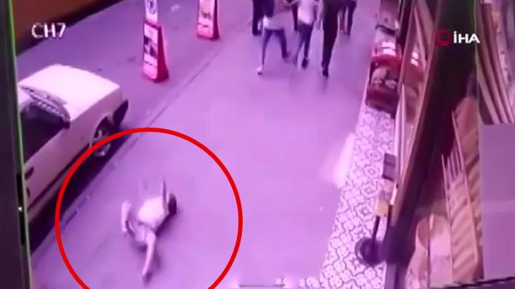 9歳の男の子がバルコニーから転落して地面に激突する映像。