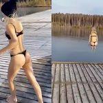 凍った湖に下着姿でダイブする女性の映像。
